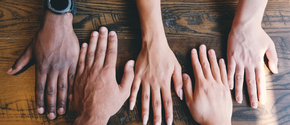 Hands laid out on a table